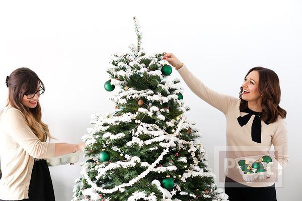 รูป 7 ต้นคริสต์มาส ตกแต่งจากของกิน ร้อยเชือก