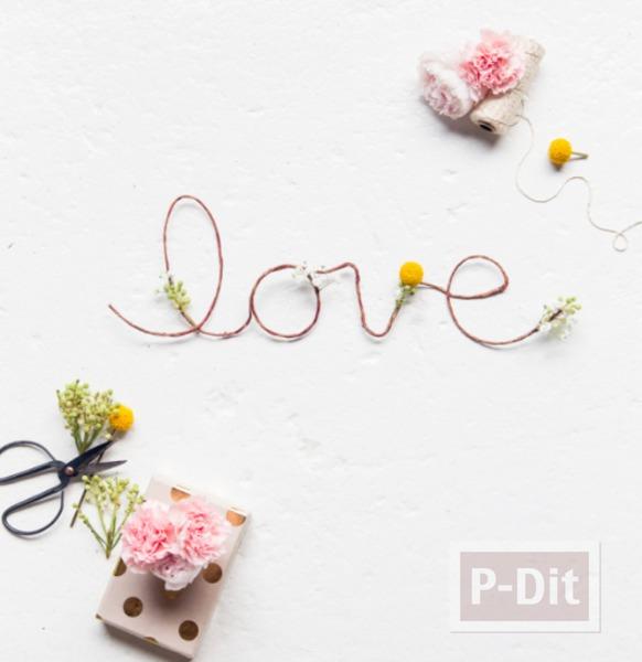 รูป 2 เขียนคำว่ารัก ผ่านเชือกเส้นเล็กๆ ประดับดอกไม้