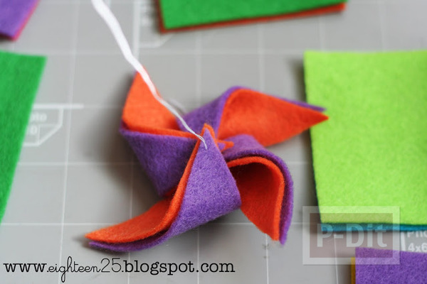 รูป 4 กิ๊บติดผม ประดับ กังหันสีสด ทำจากผ้า