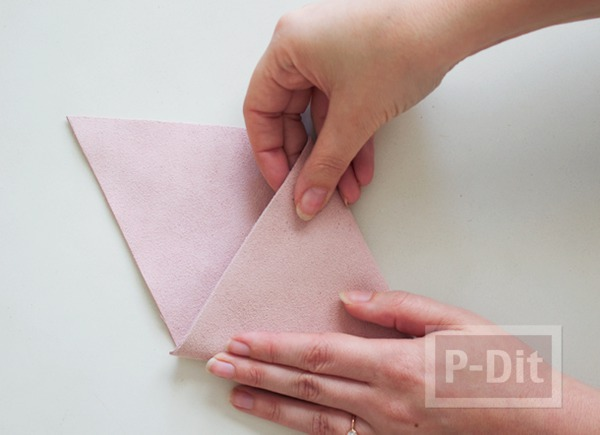 รูป 5 เย็บกระเป๋าหนัง เป็นรูปสามเหลี่ยม