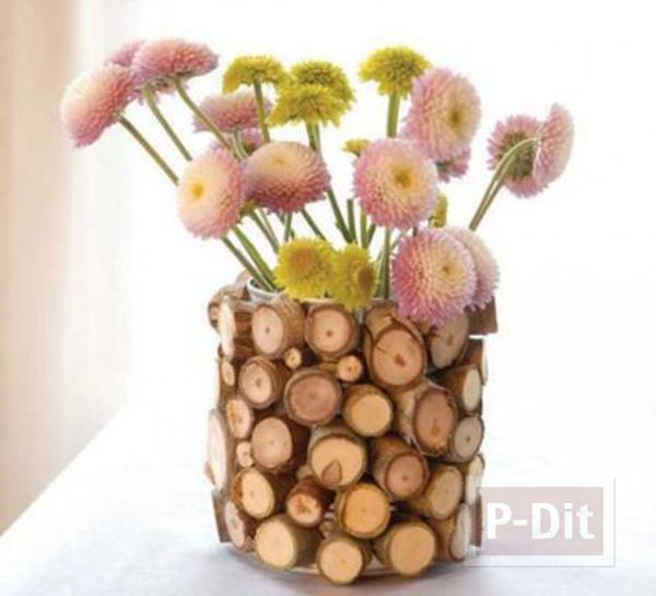 แจกันดอกไม้ ตกแต่งประดับตอไม้เล็กๆ รอบๆแจกัน