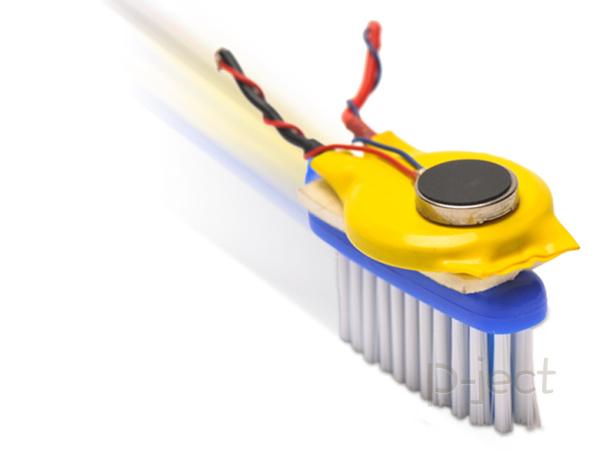 รูป 1 แปรงสีฟันหุ่นยนต์ หมุนไปมา