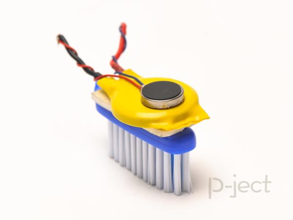 รูป 7 แปรงสีฟันหุ่นยนต์ หมุนไปมา
