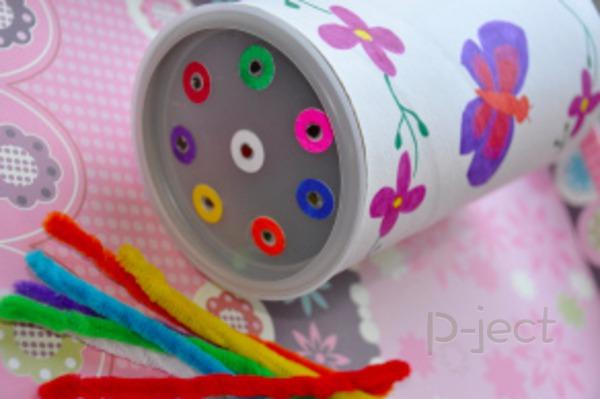รูป 1 เจาะรูกระป๋อง ทาสีสด เสียบรูด้วยลวดกำมะหยี่ (ของเล่น)