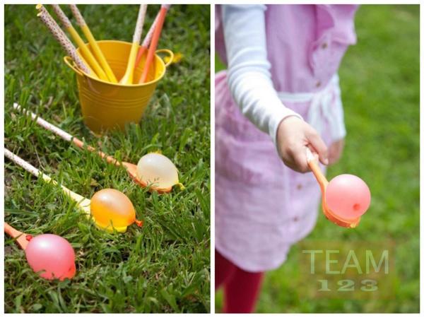 รูป 1 เกมส์ส่งลูกบอลน้ำ สนุกๆ ระหว่างทัพพีไม้